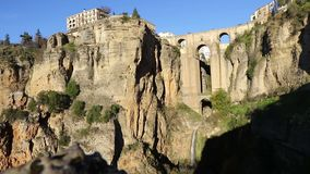 Puente Nuevo Bridge in Ronda, Andalusia, Spain. Panoramic view of The New Bridge Puente Nuevo, famous bridge over the canyon of Guadalevin river in Ronda city stock video