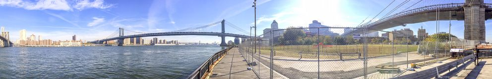 Panoramic view of New York City from Brooklyn Bridge Park Royalty Free Stock Images