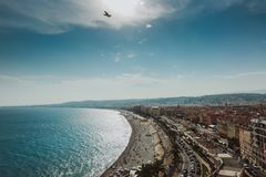 Panoramic view of Nice coastline and beach with blue sky, France. stock images