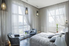 Panoramic view of nice cozy bedroom Royalty Free Stock Image