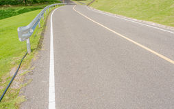 Panoramic view of nice green hill and road Royalty Free Stock Photos