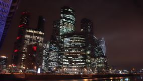 Panoramic view of the night city. Skyscrapers. Bridge with neon illumination stock video