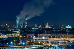 Panoramic view of night Moscow. Big city lights. Steam comes from the CHP pipes.  royalty free stock image