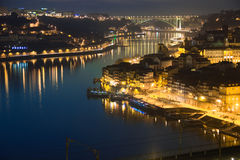 Panoramic view at night. Porto. Portugal. Panoramic view of the old town along Cais da Riveira street at night and the river Douro. Porto. Portugal Stock Photo