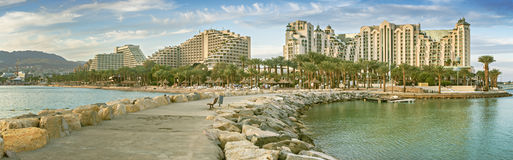 Panoramic view on the northern beach of Eilat. Eilat is a famous Israeli city with beautiful beaches and resort hotels packed with thousands of vacationers and Stock Photos