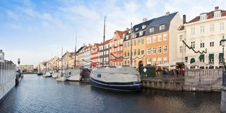 Panoramic view of the Nyhavn during the Christmas holidays with christmas ornament. In Danish it means. `new harbor` and it`s one of the most famous landmark in stock photos