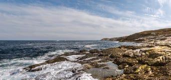 Panoramic view of ocean shore Stock Images
