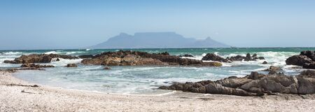 Free Panoramic View Of Table Mountain With Beach, Ocean And Rocks In Foreground Stock Image - 183668581