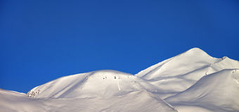 Panoramic view on off-piste slope and blue clear sky in morning Stock Photo