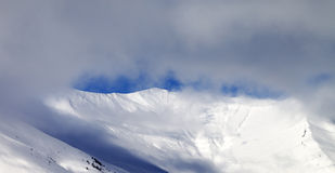 Panoramic view on off-piste slope in mist Stock Photos