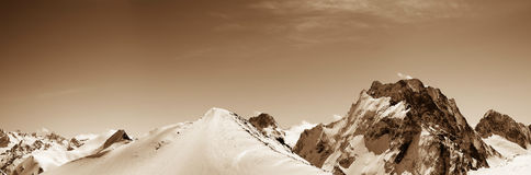 Panoramic view on off-piste slope in snow winter mountains Royalty Free Stock Image