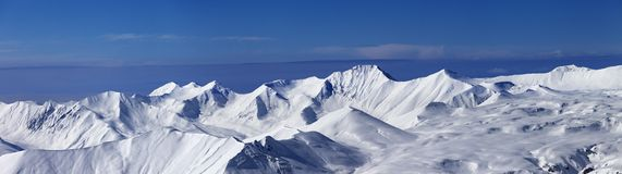 Panoramic view on off-piste slope and snowy plateau at nice day Stock Photography
