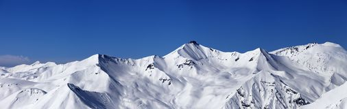 Panoramic view on off-piste slopes and blue sky at nice day Royalty Free Stock Images