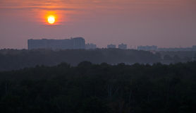 Panoramic view ofred sunrise over city Stock Photo