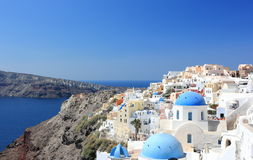 Panoramic view of Oia. Santorini Island, the Cyclades, Greece. Oia or Ia is a small town and former community in the South Aegean on the islands of Thira Stock Photography