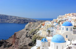 Panoramic view of Oia. Santorini Island, the Cyclades, Greece. Oia or Ia is a small town and former community in the South Aegean on the islands of Thira Stock Images