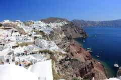 Panoramic view of Oia. Santorini Island, the Cyclades, Greece. Oia or Ia is a small town and former community in the South Aegean on the islands of Thira Stock Photo