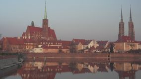 Panoramic view on the old architecture on Cathedral Island in Poland. Panoramic view on the old architecture on Cathedral Island Ostrow Tumski at sunset in stock video