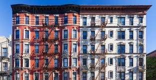 Panoramic view of old brick building against blue sky background stock photos