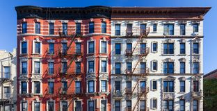 Panoramic view of old brick building against blue sky background in New York City. Panoramic view of old brick building against blue sky background in the East royalty free stock images
