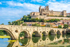 Panoramic view at the Old Bridge over Orb river with Cathedral of Saint Nazaire in Beziers - France Royalty Free Stock Photography