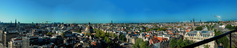 Panoramic view of old city, amsterdam. Besides providing a stunning backdrop to the city's historical centre, floating down Amsterdam's canals is one of the Royalty Free Stock Photography