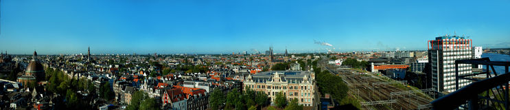 Panoramic view of old city, amsterdam. Besides providing a stunning backdrop to the city's historical centre, floating down Amsterdam's canals is one of the Royalty Free Stock Photo