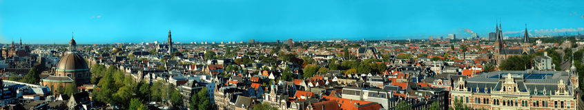 Panoramic view of old city, amsterdam. Besides providing a stunning backdrop to the city's historical centre, floating down Amsterdam's canals is one of the Royalty Free Stock Photos