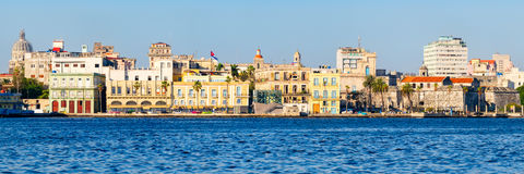 Panoramic view of Old Havana in Cuba with several seaside colorful buildings and landmarks. High resolution panoramic view of Old Havana in Cuba with several Royalty Free Stock Photography