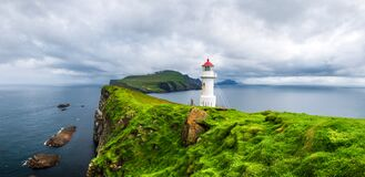 Panoramic view of old lighthouse on the Mykines island