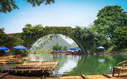 Panoramic view of old stone arch bridge. Old stone arch bridge in yulong river ,yangshuo,China Royalty Free Stock Photo