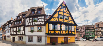 Panoramic view on old street with half timbered houses in Colmar Stock Photo