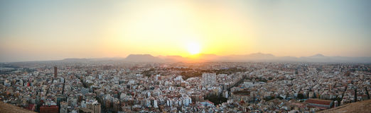 Panoramic view of the old town of Alicante, backlit at sunset from the top of the castle of Santa Barbara Royalty Free Stock Photo