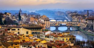 Ponte Vecchio bridge over Arno river in Old Town Florence, Italy. Panoramic view of the Old Town Florence with Ponte Vecchio bridge and Arno river, Tuscany stock photography