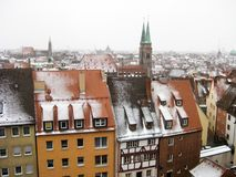 Panoramic view of the old town of Nuremberg in wintertime. Panoramic view from the hill to the brown tile roofs of the houses in the old town of Nuremberg in Stock Images