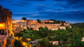 Panoramic view of an old town Pitigliano at the dusk, small old town in Maremma Region in Tuscany, Italy royalty free stock image