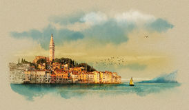 Panoramic view on old town Rovinj at sunset with reflection in water. The Istrian Peninsula, Croatia. Watercolor sketch Royalty Free Stock Images