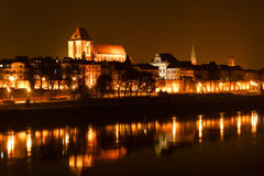 Panoramic view of old town of Torun at night reflected with many royalty free stock images