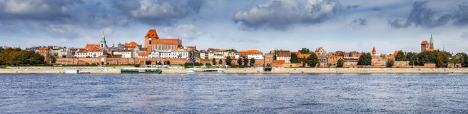 Panoramic view of old town in Torun on Vistula bank, Poland. Royalty Free Stock Photos