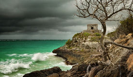 Panoramic view of the old Watchtower in the ancient city of Tulum on the Caribbean coast before it rains, Mexico