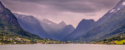 Panoramic View of Olden village in Briksdalsbreen Glacial valley. In Norwegian Innvikfjord fjord Norway Stock Images