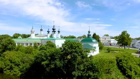 Panoramic view of Oldest part of medieval Russian town Suzdal with white church. Architectural ensemble of old russian architecture. Golden round tour trip in stock video