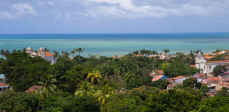Panoramic view of Olinda, Brazil. Panoramic landscape of Olinda village, with the sea, trees and old churches at Pernambuco, Brazil Stock Image