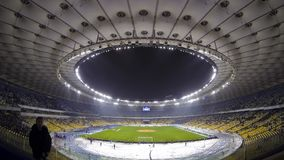 Panoramic view of Olympic stadium in Kyiv, Ukraine (Time Lapse). KYIV, UKRAINE - DECEMBER 12, 2013: Panoramic view of Olympic stadium during UEFA Europa League stock footage