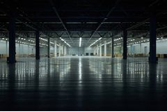 Free Panoramic View On Empty Pavilion Hall Under Construction, With Dark Front And Light On The Back Wall, Floor Reflection. Interior M Stock Image - 127721471