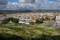 Panoramic view of one of the white villages. Small hamlet of southern Spain. Sky full of cottony clouds stock image
