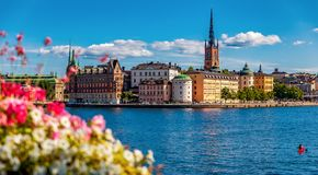 Panoramic view onto Stockholm old town Gamla Stan and Riddarholmen church in Sweden stock image