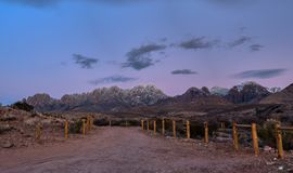 Panoramic view of the Organ Mountains in New Mexico. Campground sunset with snowy mountains stock image
