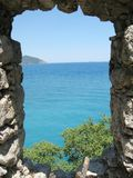 Panoramic view out of window in castle turkey. Panoramic view out of window in ancient castle olympos turkey Royalty Free Stock Photo