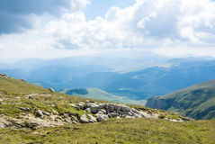 Panoramic view over the Carpatian mountains, green valleys and b Stock Photos